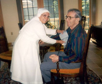 Oblate Sister caring for a priest in a retirement home